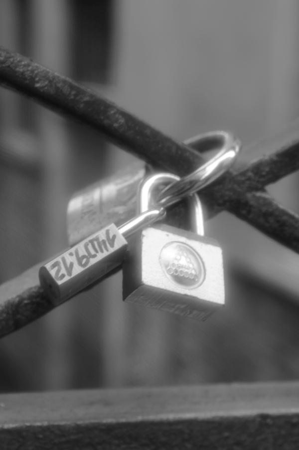 Lovers locks on a bridge in Venice